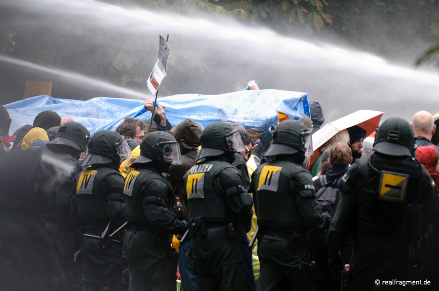 A water-cannon is used against protesters